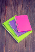 Note books on wooden background — Foto de Stock