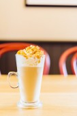 Latte cup in coffee shop — Stock Photo