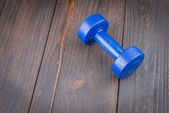Dumbbell on wood background — Photo