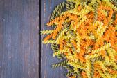 Raw pasta on wood — Stock Photo