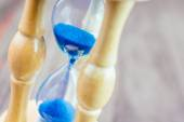 Hour glass with blue sand — Stock Photo