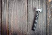 Hammer tool on wood — Stock Photo