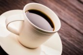 Coffee mug on wood — Stock Photo