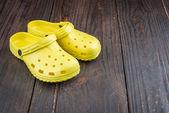 Plastic yellow slippers — Stock Photo