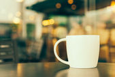 Coffee cup in cafe — Stock Photo