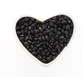 Black beans isolated on white background — Stock Photo
