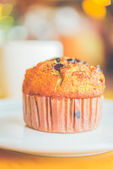 Chocolate muffin in coffee shop — Stock Photo