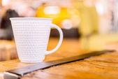 Coffee mug in coffee shop — Stock Photo