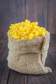 Raw pasta on wooden background — Stock Photo
