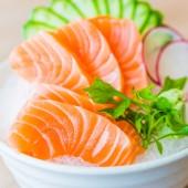 Salmon sashimi in white dish — Stock Photo