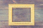 Photo frame on wooden background — Stock Photo