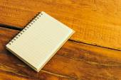 Note book on wooden background — Stockfoto