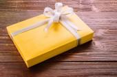 Gift box on wood background — Stock Photo