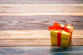 Gift box on wood background — Stock Photo