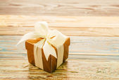 Gift box on wooden background — Stock Photo