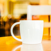 Coffee cup in coffee shop — Stock Photo