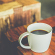 Black coffee in white cup — Stock Photo #64205999