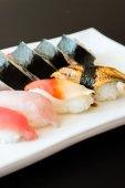 Sushi rolls in white dish — Stock Photo