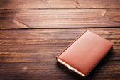 Note book on wooden background — Stock Photo