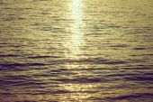 Sea waves with sun flare — Stock Photo