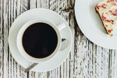 Cranberry cake and coffee cup — Stock Photo
