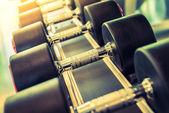 Dumbbells set in gym — Foto Stock