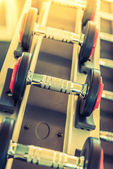 Dumbbells set in gym — Stock Photo