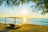 Beach bed with sun flare — Stock Photo
