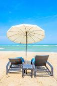 Sun loungers and umbrellas — Stock Photo