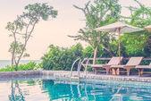 Resort pool with umbrellas — Stock Photo