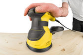 Random orbit sander at work — Stock Photo