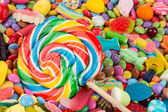 Lollipop on sweets — Stock Photo