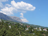 Simeiz settlement and clouds over the mountain Ai-Petri in Crimea — Stock Photo