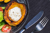 Acorn squash with sour cream and salad. — Stock Photo