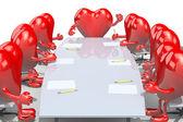 Many hearts meeting around the table — Stock Photo