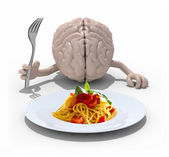 Brain with hands, fork in front of a spaghetti dish — Stock Photo