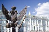 Monarchy symbol against the Winter Palace — Stock Photo