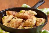 Dumplings fried with onion — Stock Photo