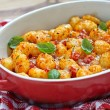 Gnocchi with tomato sauce and parmesan cheese — Stock Photo #52924329