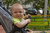 Adorable baby boy in a stoller — Stock Photo