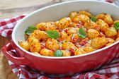 Gnocchi with tomato sauce and parmesan cheese — Stock Photo