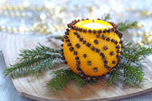 Aromatic Christmas orange with candle — Stock Photo