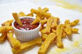 Polenta fries with tomato sauce — Stock Photo