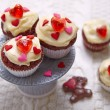 Red velvet cupcakes decorated with hearts — Stock Photo #62680365