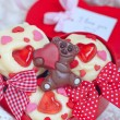 Red velvet cupcakes decorated with hearts — Stock Photo #63432517