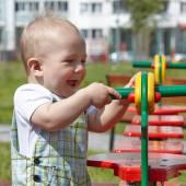Kid playing on playground — Stock Photo