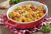Pasta casserole with cheese and ham — Stock Photo