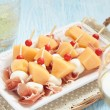 Appetizer with melon, cheese and ham — Stock Photo #72196983