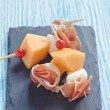 Appetizer with melon, cheese and ham — Stock Photo #72197097
