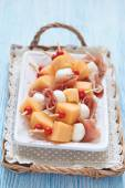 Appetizer with melon, cheese and ham — Stok fotoğraf